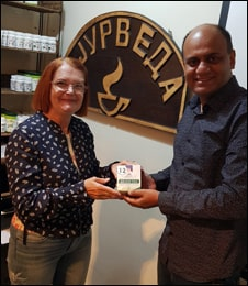 Dr. Vikram Chauhan Presenting Arjun Tea to Ms Divna Shipovikj at Planet Ayurveda Centre, Macedonia