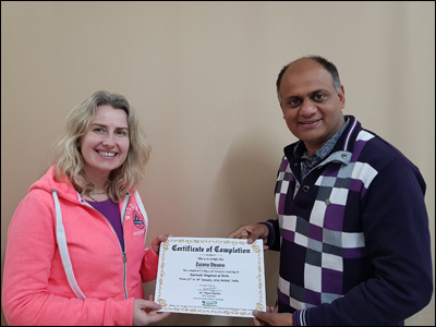 Dr. Vikram Chauhan (MD-Ayurveda) Presenting 8 Days Training Certificate to Ms. Zuzana Olexova at Planet Ayurveda Centre