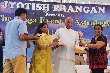 Dr. Meenakshi Chauhan being Awarded by Sh. Kaptan Singh Solanki (Honorable Governor of Punjab & Haryana)