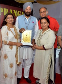 Dr. Meenakshi Chauhan being Awarded by Rana Gurmeet Singh Sodhi (Sports and Youth Affairs Minister of Punjab)