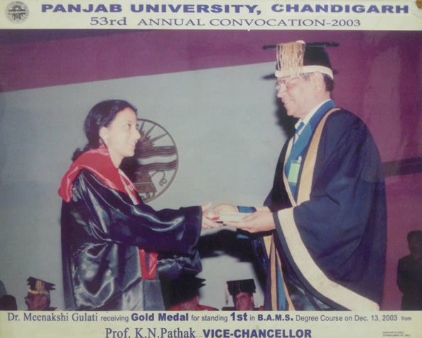 Dr. Meenakshi Chauhan Receiving Gold Medal for standing 1st in B.A.M.S. Degree Course on Dec. 13, 2003 from Prof. K.N. Pathak ( VICE CHANCELLOR)