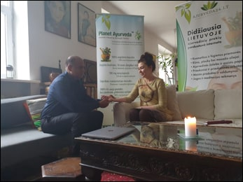 Dr. Vikram Chauhan with Patients during Ayurvedic Consultation in Vilnius, Lithuania