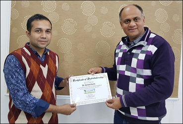 Dr. Vikram Chauhan (MD-Ayurveda) Presenting Certificate of Distributorship to Mr. Ashraful Karim (Distributor in Bangladesh) at Planet Ayurveda Centre