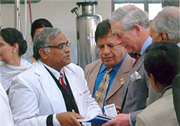 Dr. Madan Gulati presenting Arjun tea to Prince Charles of UK and his wife Camilla Parker