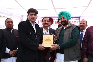 Received award for services from health Minister S. Balbir Singh Sidhu